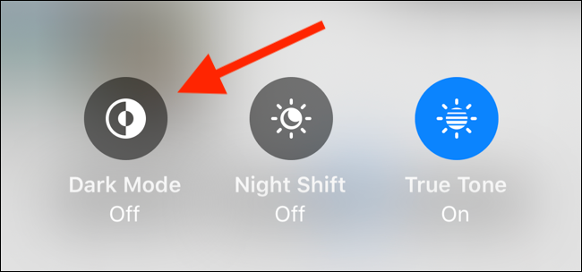 Tap on Dark Mode toggle in Brightness slider to enable dark mode