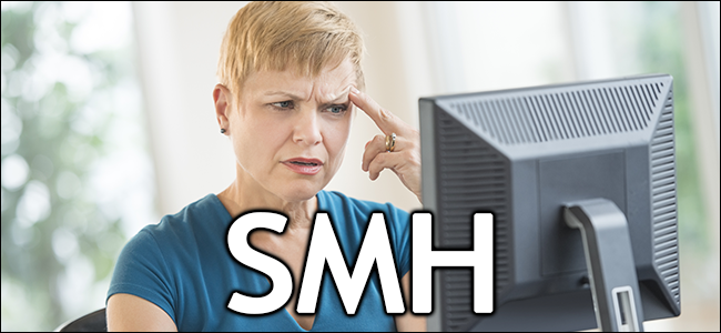 A woman looks confused at her computer.