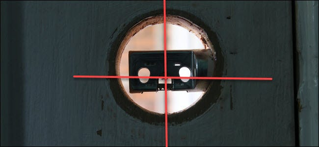A lock cavity with a bolt in it, and lines crossing through the vertical and horizontal center.