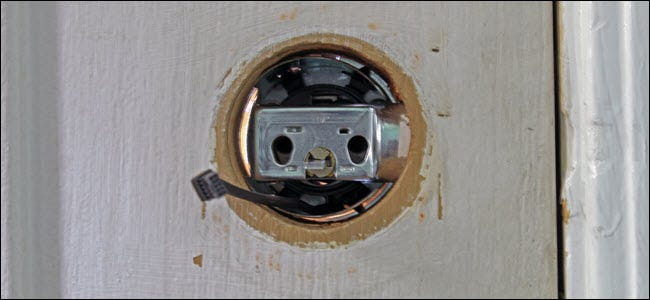 The door lock hole interior, showing the wiring running beneath the bolt assembly.