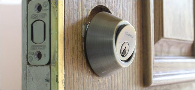 The key assembly of a lock, slightly tilted out of the door.