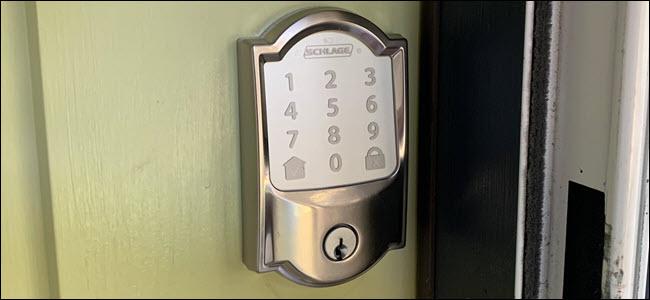 A Schlage Encode Wi-Fi lock on a green door.