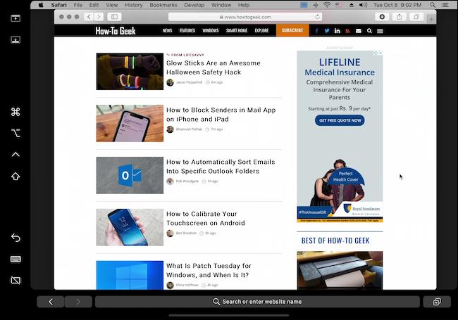Sidecar UI showing Safari running How to Geek Website