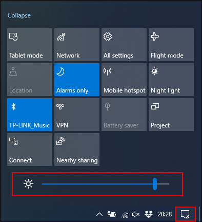 Click and move the Brightness slider to the left to reduce screen brightness.