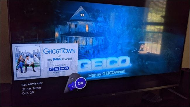 A GEICO advertisement displayed over a commercial on live TV on a Roku TV.