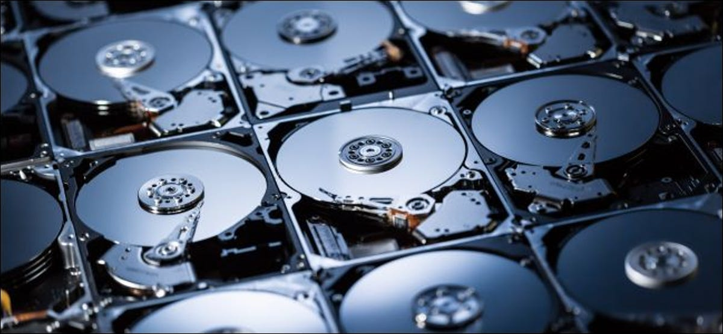 The platters inside multiple hard drives.