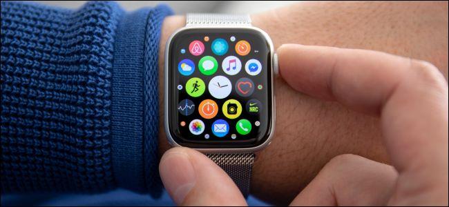 An Apple Watch Series 4 watch on a man's wrist.