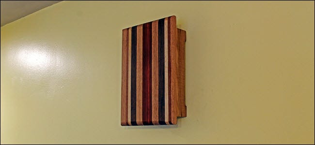 A Wooden chime box near a ceiling.