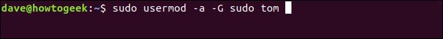 sudo usermod -a -G sudo tom in a terminal window