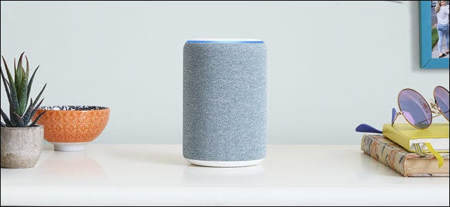 A gray Amazon Echo roughly in the center of a room.