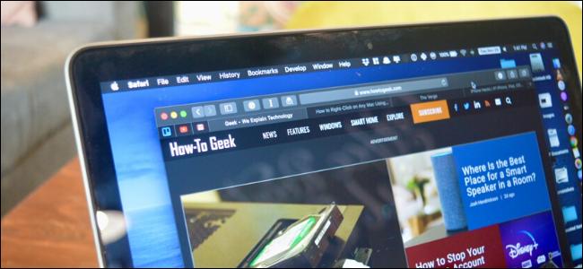 MacBook showing How to Geek website in dark mode on Safari