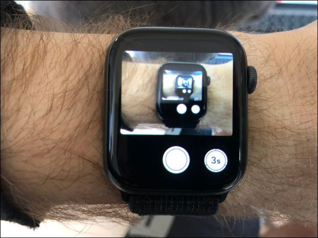 An Apple Watch on a man's arm taking a photo.