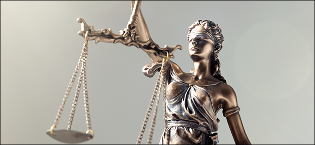 """A statue of """"Justice,"""" a blindfolded woman holding the metaphorical scales of law."""