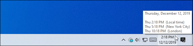 Mousing over the taskbar clock for additional time zone information.