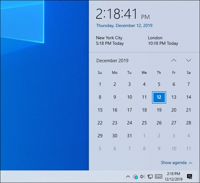 Windows 10's clock panel showing the time in three time zones.