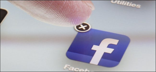 """A finger about to press the """"X"""" delete button on the Facebook app."""