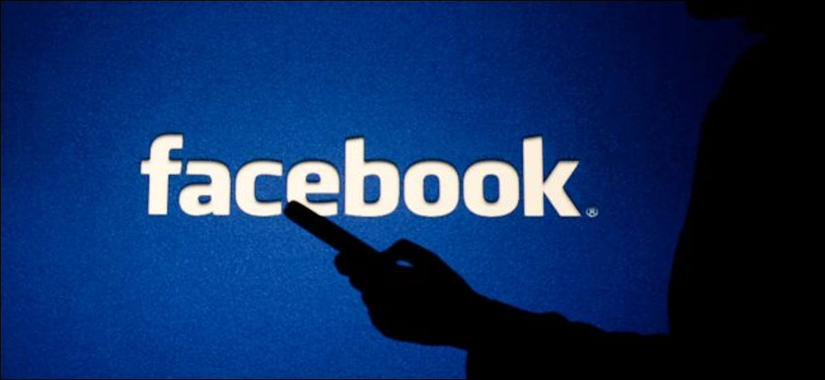 A shadowy figure using a smartphone in front of the Facebook logo.