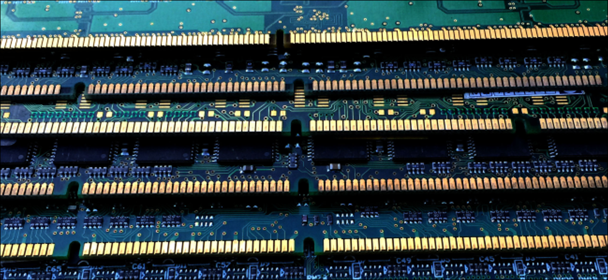 Bare RAM modules with green circuit boards and gold connectors.