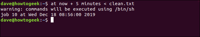 """An """"at now + 5 minutes < clean.txt"""" command in a terminal window."""