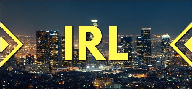 "The initialism ""IRL"" superimposed over a Los Angeles cityscape."