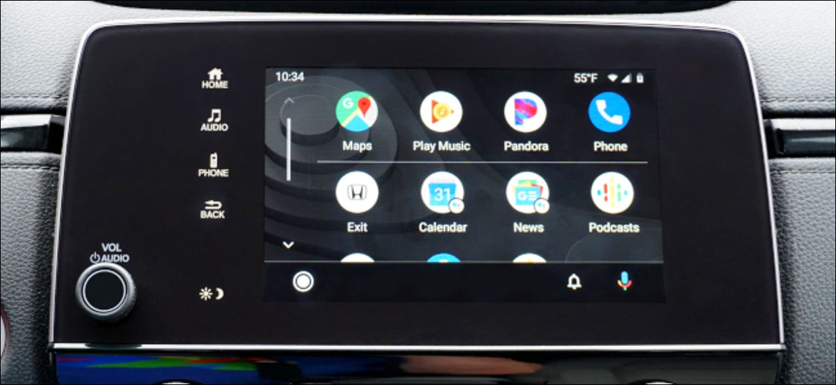 A touch screen in a vehicle displaying a phone's apps via Android Auto.