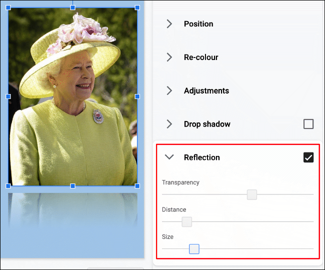 An image of Queen Elizabeth II in Google Slides, with the reflection effect applied, with modified settings