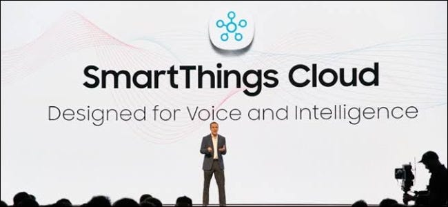 A man on a stage in front of a huge Samsung SmartThings Cloud backdrop.