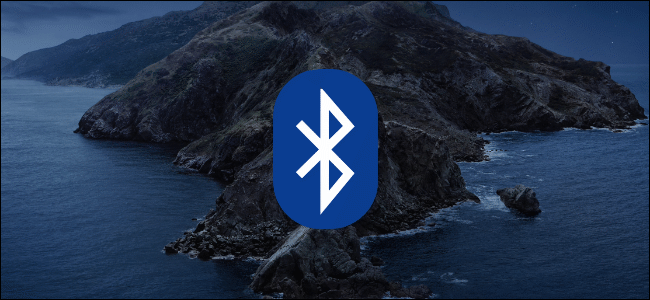 The Bluetooth logo on a macOS background of a rocky seashore.