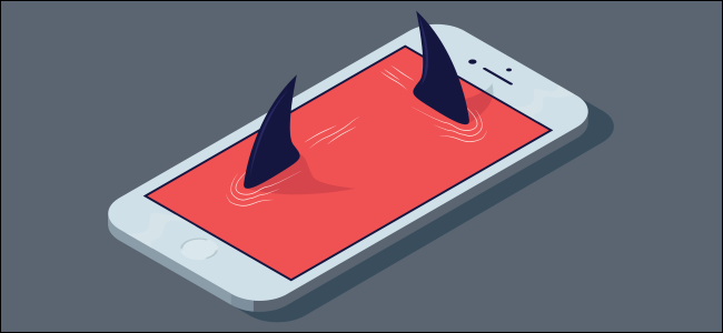 Shark fins emerging from a smartphone's display.