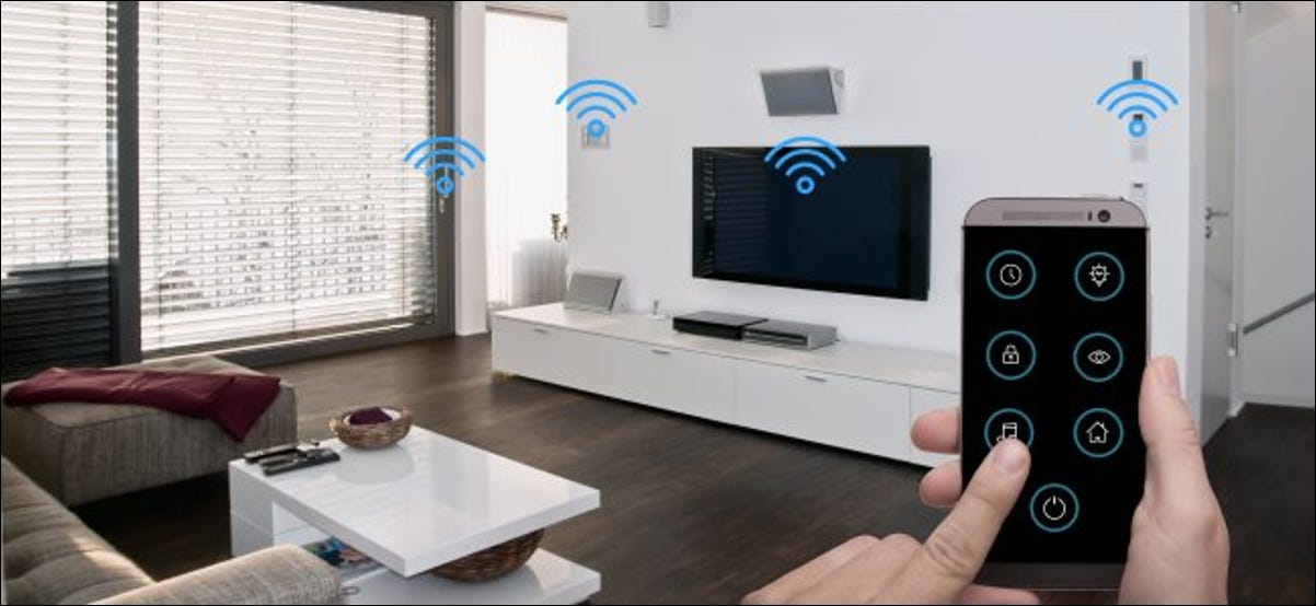 A hand holding a smartphone and using an app to control wireless smart devices in a living room.