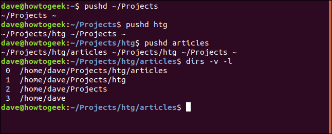 "The ""pushd ~/Projects,"" ""pushd htg,"" ""pushd articles,"" and ""dirs -v -l"" commands in a terminal window."