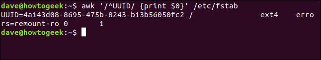 "El comando ""awk '/ ^ UUID / {print $ 0}' / etc / fstab"" en una ventana de terminal."