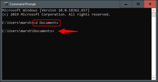 """O comando """"cd Documentos"""" no prompt de comando."""