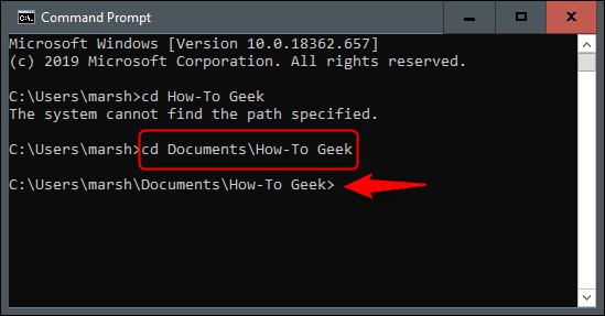 """O comando """"cd Documentos  How-To Geek"""" no prompt de comando."""
