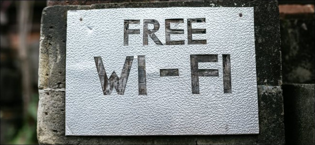 A free Wi-Fi sign on a brick wall.