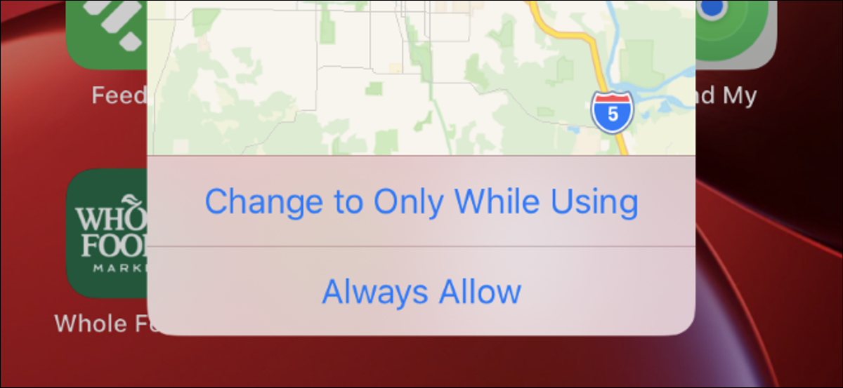A background location message showing a map on an iPhone with iOS 13.