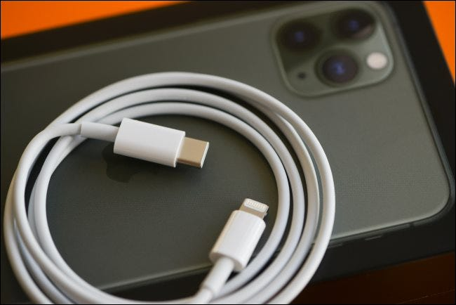 A Lightning-to-USB-C fast-charging cable resting on an iPhone 11.
