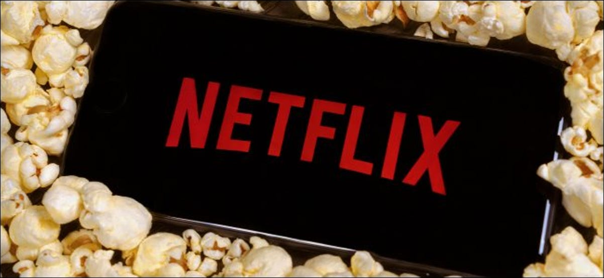 A smartphone on a pile of popcorn showing the Netflix logo.