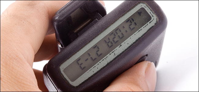 A hand holding a pager.