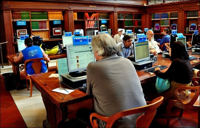 People using public computers in a New York City library