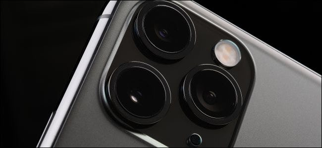 The camera lenses on an iPhone 11 Pro Max.