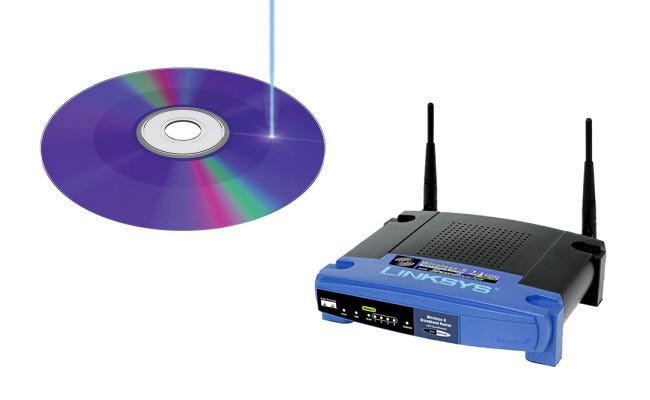 A CD-R next to a Linksys router.