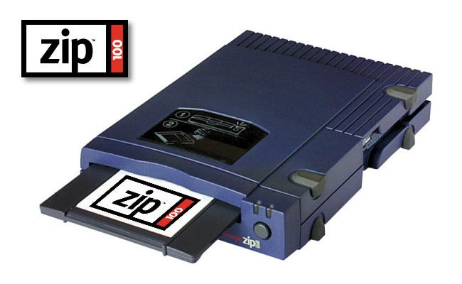 A 100 MB Iomega Zip Drive with a disk half inserted.