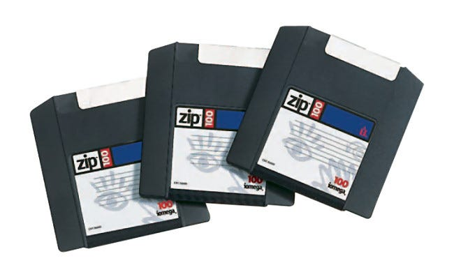 Three Iomega 100 MB Zip Disks.