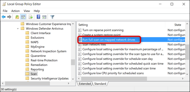 """Haga doble clic en la configuración de directiva de grupo """"Ejecutar análisis completo en la unidad de red asignada""""."""