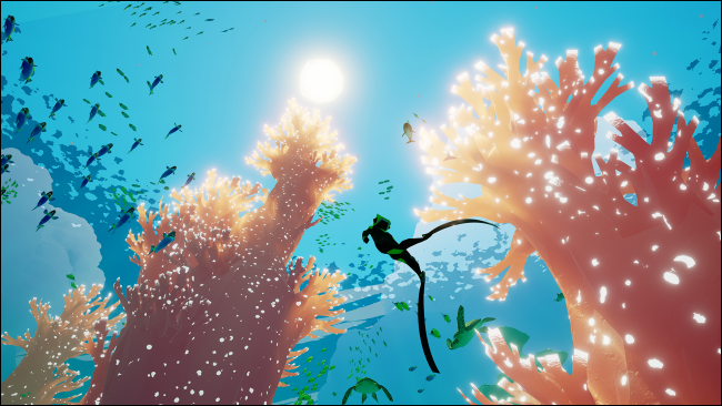 "A diver swimming just below the ocean's surface in ""Abzû."""