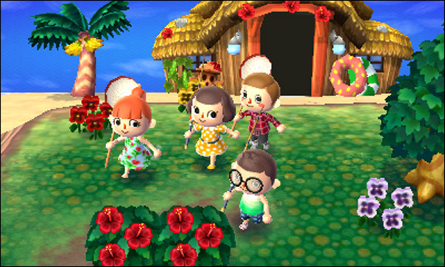 "Four characters in front of a beach house in ""Animal Crossing: New Leaf."""