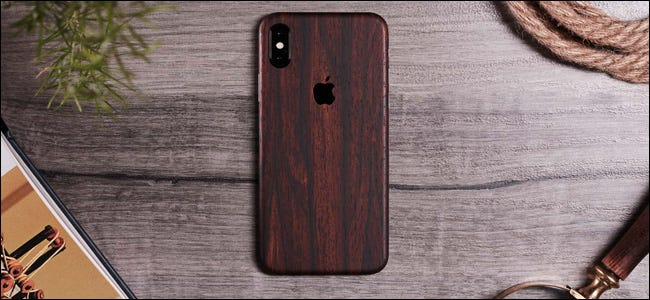 A dbrand phone case on an iPhone XS Max.