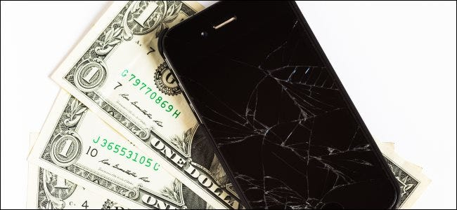 A broken iPhone and some dollar bills.