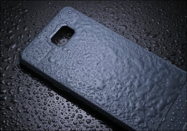 A smartphone case covered in water.